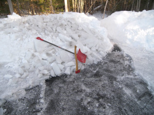 ice in driveway, axe and shovel