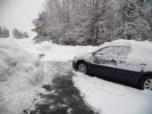 Snow on car and driveway